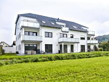 Mehrfamilienhaus mit Terasse / Balkon